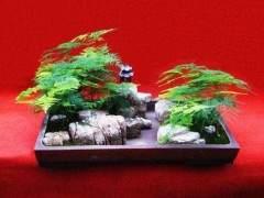 一种带电子雾化器的山水盆景