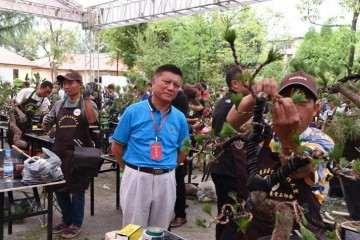 中国盆景协会授予韦金笙中国盆景艺术大师称号